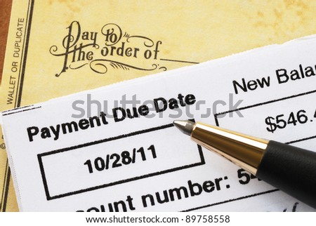 Paying the credit card bill on time concept of financial health - stock photo