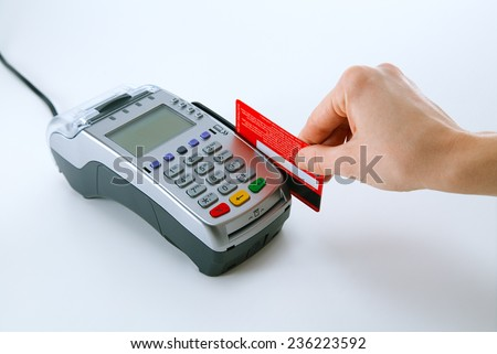 Paying with credit card terminal - stock photo