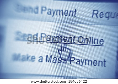 Payment button - mouse click on computer screen - stock photo