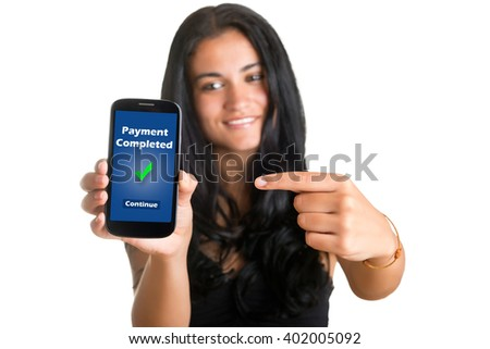 Payment Completed. Young woman pointing at a mobile phone and smiling, isolated in white - stock photo