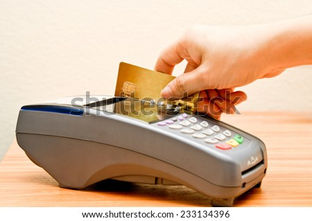 payment machine and Credit card in supermarket - stock photo