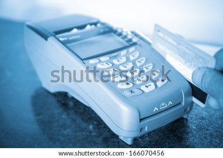 payment on a credit card through the point of sale machines - stock photo