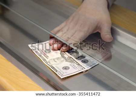 Payment one Banknotes in the Bank