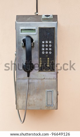 Payphone on the wall - stock photo