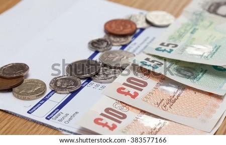 Payslip and money close up shot - stock photo