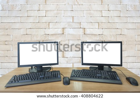 pc computer with white screen on white brick wall - stock photo
