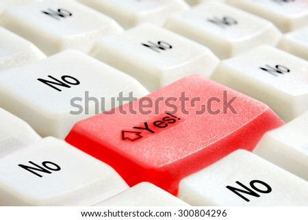 """PC keyboard: big red button with """"yes"""" and a lot of buttons with """"no"""". - stock photo"""