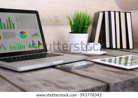 PC, laptop, tablet and phone on wooden table. - stock photo