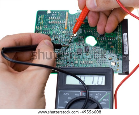 PCB diagnostics by means of a multimeter - stock photo