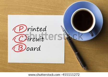 PCB Printed Circuit Board - handwriting on paper with cup of coffee and pen, acronym business concept