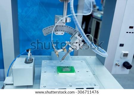 PCB Processing on CNC machine - stock photo