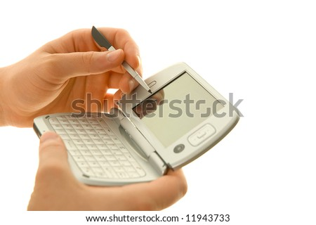 PDA and stylus in hand - stock photo