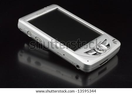 PDA on shiny black background - stock photo