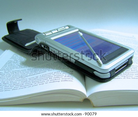 PDA on top a book - stock photo