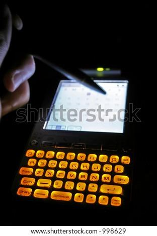PDA under low light - stock photo