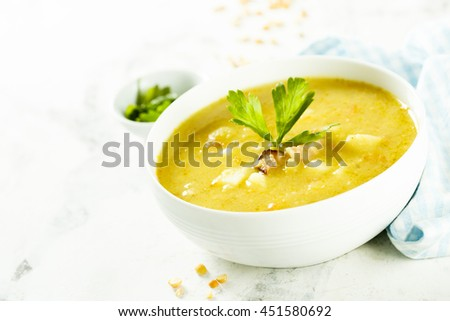 Pea and lentil soup with smoked meat - stock photo