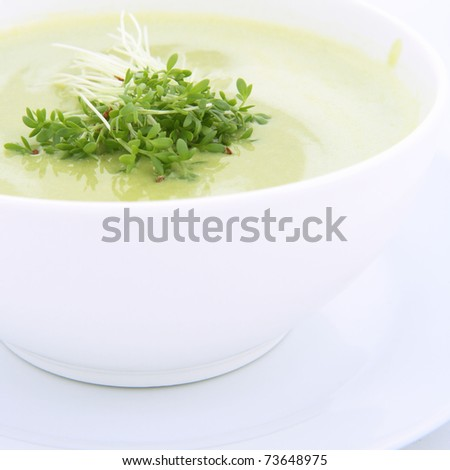 Pea and mozzarella soup decorated with some cress - stock photo