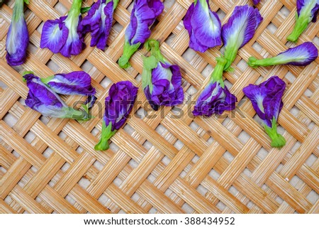 Pea flowers with woven bamboo background - stock photo