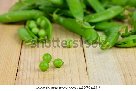pea green peas close-up on wooden background. Vitamins. Of rural workers harvest. Country style. Summer. - stock photo