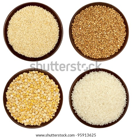 Pea skinned and split, sesame seeds, raw rice and buckwheat  in a brown plates isolated on white - stock photo