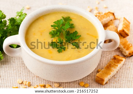 Pea soup in the white dish - stock photo