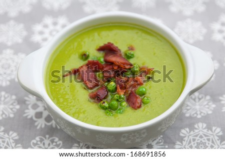 Pea soup with bacon - stock photo