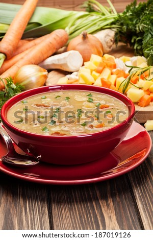 Pea soup with bacon and sausage in a bowl