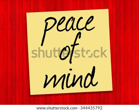 Peace of Mind inspirational text on yellow sticky note and red background - stock photo
