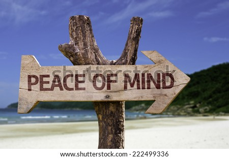 Peace of Mind wooden sign with a beach on background - stock photo