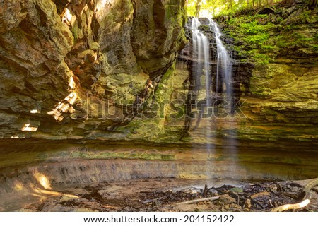 Peace of Paradise. Beautiful Tannery Falls tumbles over a sandstone cliff.  Munising, Michigan - stock photo