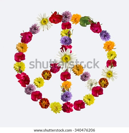 Peace sign made of fresh flowers, representing diversity in peace. - stock photo