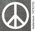 Peace symbol on asphalt - stock photo