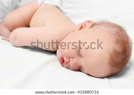 Peaceful baby sleeping in a bed, close up