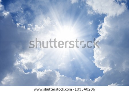 Peaceful background - bright sun shines, blue sky, white clouds - heaven - stock photo