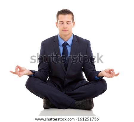 peaceful businessman meditating on white background - stock photo