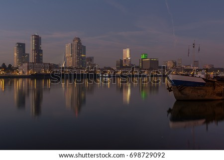 Peaceful cityscape with boat and building reflections in the water