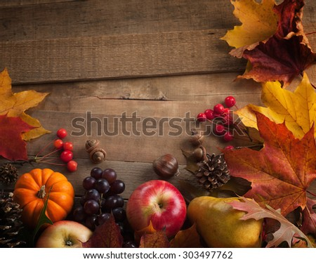 Peaceful Fall Fruit, Leaf, Acorn Still Life Arrangement on Rustic Wood Board Table Background with room or space for copy, text, your words.  Horizontal dark, warm,  vintage tone. Good as vertical