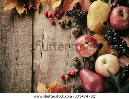 Peaceful Fall Fruit, Leaf, Acorn Still Life on Rustic Wood Board Table Background with Room or Space for Copy, Text, Your Words.  Horizontal Warm, dark faded Vintage Tone.  Looks good as vertical.