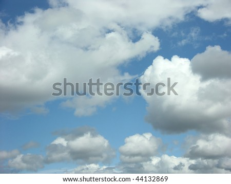 Peaceful fluffy clouds - stock photo