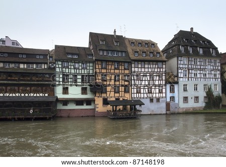 peaceful idyllic scenery in Strasbourg with timbered houses waterside (Alsace/France) - stock photo