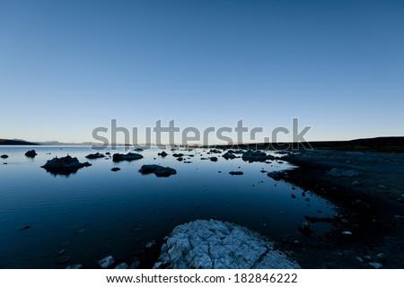 Peaceful Mono Lake approaching nightfall. - stock photo