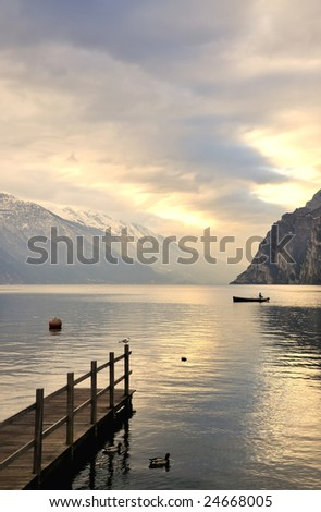 peaceful morning at northern shores of Lake Garda, Italy - stock photo