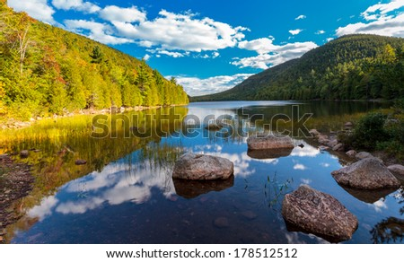 peaceful pond in Acadia national park, blue cloudy skies and morning light  - stock photo