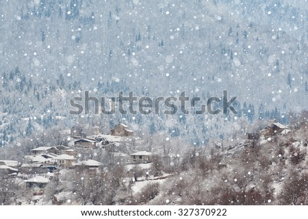 Peaceful snowy morning in Svaneti village - stock photo