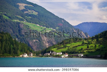 Peaceful village by the lake in Swiss alps