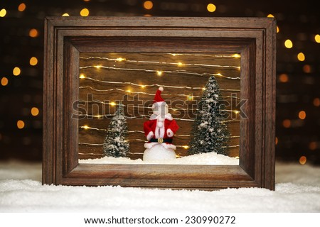 Peaceful winter scene with snowman - stock photo