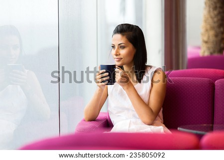 peaceful woman having cup of coffee in coffee shop - stock photo