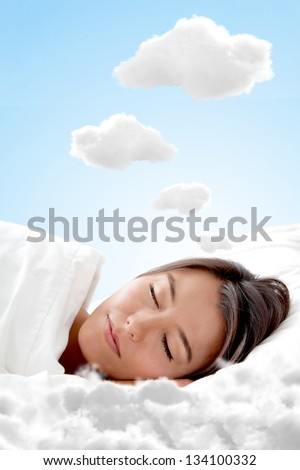 Peaceful woman sleeping on a cloud and having sweet dreams - stock photo