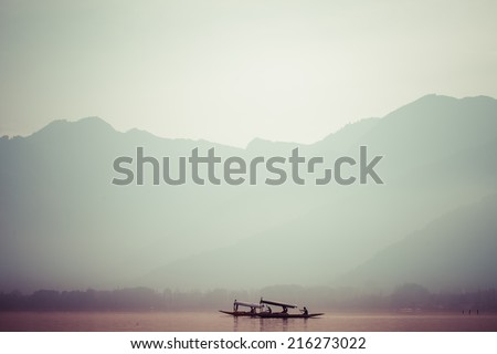 Peacefully Dal lake with snow mountain background in Srinagar, Kashmir India - stock photo