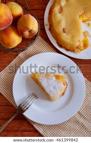Peach caramel turnover pie sprinkled with sugar powder. Delicious summer dessert.